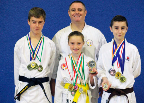 Cian Hogan (1st dan), Padraig Hassett (3rd kyu), and Michelle Hurley (7th kyu)