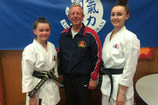 ASK Course & Dan Grading : 1st Dan - Faye Manning (left), Sensei Hazard 7th Dan (centre), 2nd Dan - Chloe Jones (right)