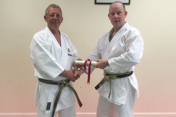 Sensei Matt Corrall awarded 5th Dan by Sensei Dave Hazard 7th Dan.